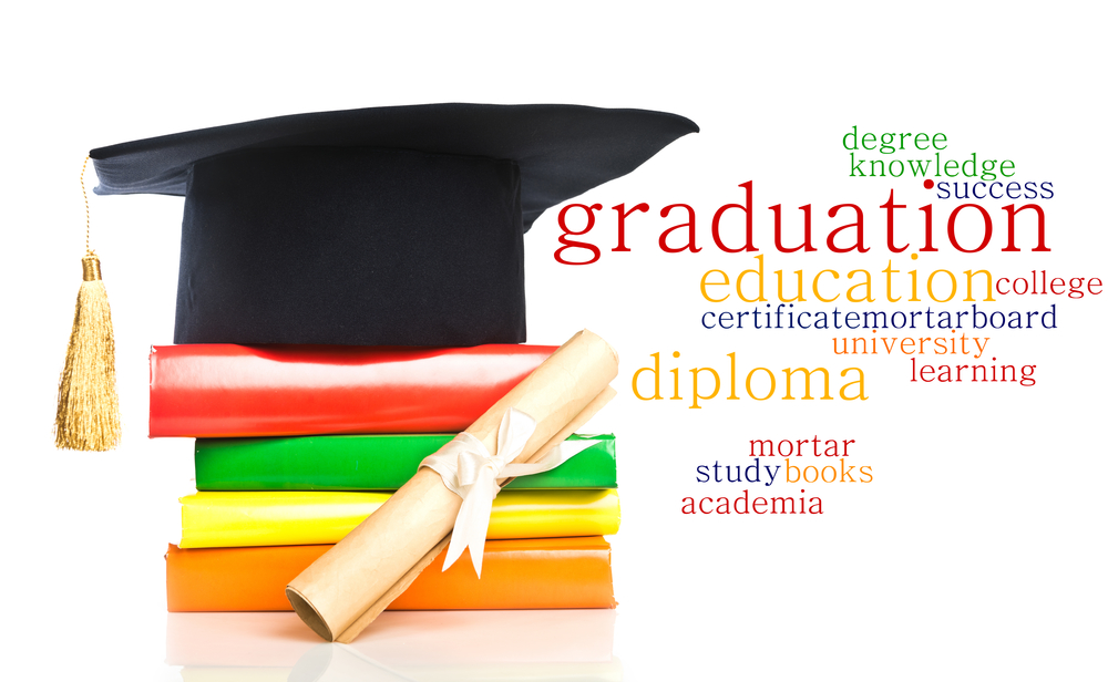 mortarboard and vintage graduation scroll, tied with  ribbon, on a stack of books